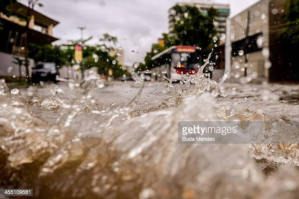 Bus tries to cross the Professor Eurico Rabelo street in front the Maracana stadium after heavy rains flooded the area on December 11 2013 in Rio de...