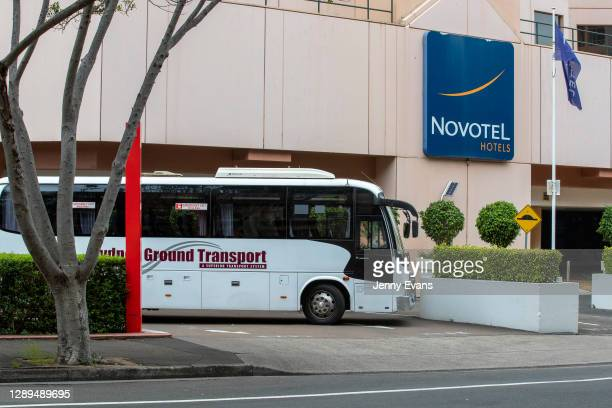 Bus used to ferry United Airline crew to the airport is seen in front of the Novotel Hotel in Darling Harbour on December 03, 2020 in Sydney,...