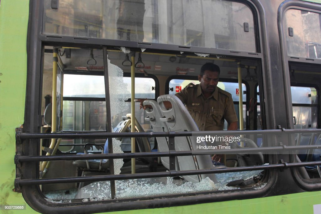 TMT Bus Vandalized during protest, after the clashes between Dalit groups and supporters of right-wing Hindutva organisations broke out during the 200th anniversary celebrations of the Bhima-Koregaon battle in Pune district, on January 2, 2018 in Mumbai, India. Violent protests erupted in several parts of Mumbai and Thane, with protesters damaging buses, blocking roads, staging rail rokos and forcing shops to shut down on Tuesday, a day after a 28-year-old Dalit died in Pune district following an altercation between two groups during celebrations to mark the bicentenary of a British-Peshwa war. In the Thane region of Maharashtra near Mumbai, section 144 has been imposed till January 4.