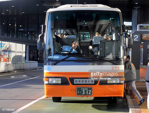 A bus which picks up and delivers passengers to and from Tokyo hotels picks up passengers at Narita International Airport near Tokyo Japan