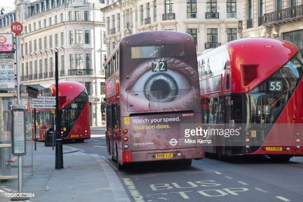 Bus with a giant eye on the back on Regent Street in London's main shopping and retail area normally full of thousands of shoppers and traffic is...
