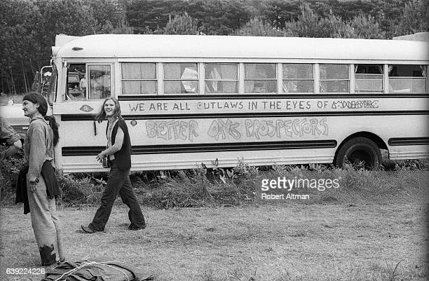 A bus with a sign that says 'We are all outlaws in the eyes of Better Days Prospectors' during the Alternative Media Conference at Goddard College in...