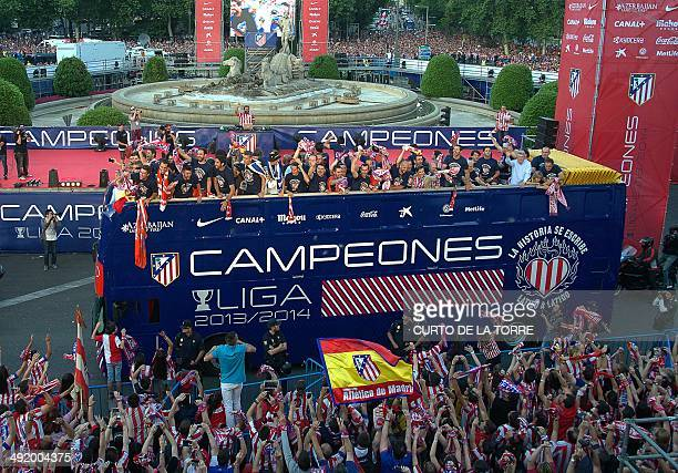 A bus with Atletico de Madrid football team celebrating their Spanish league title arrives at Neptuno square in Madrid on May 18 2014 Atletico Madrid...