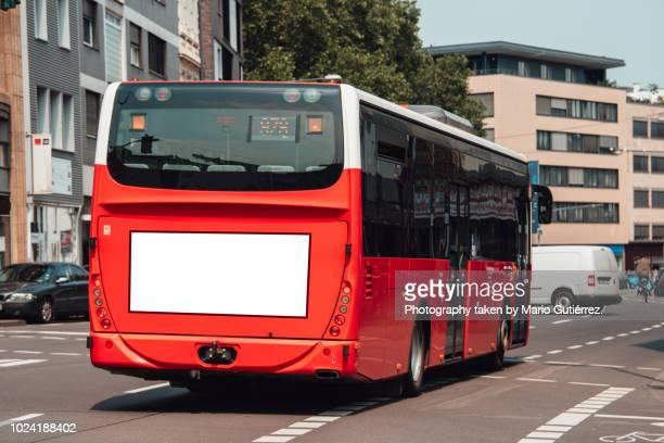 bus with blank billboard - bus fotografías e imágenes de stock