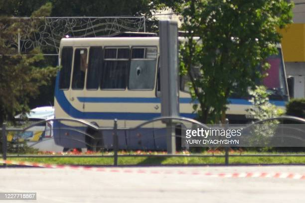 Bus with passengers who have been taken hostage is seen in the city of Lutsk, some 400 kilometres from the capital Kiev, on July 21, 2020. -...