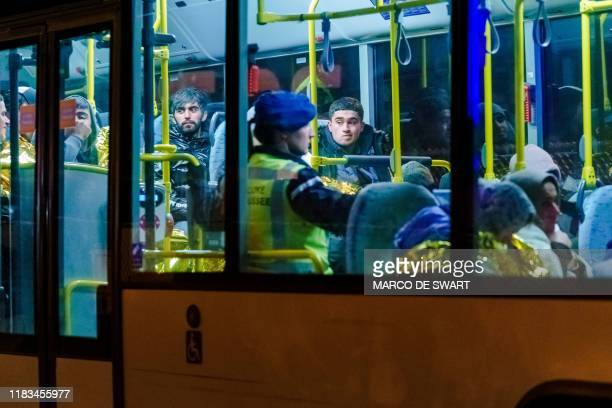 A bus with refugees drives away from the DFDS ferry in the harbour of Vlaardingen The Netherlands on November 19 after 25 stowaways were found...