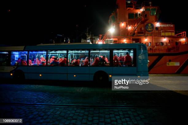A bus with rescued migrants onboard transfers them to the Red Cross Care unit Malaga