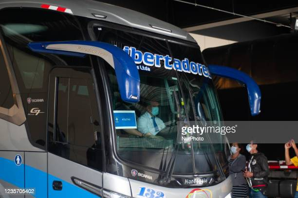 Bus with the Brazilian football team members leaves the Grand Hyatt hotel as members of the Brazil federation of football team board their bus at the...