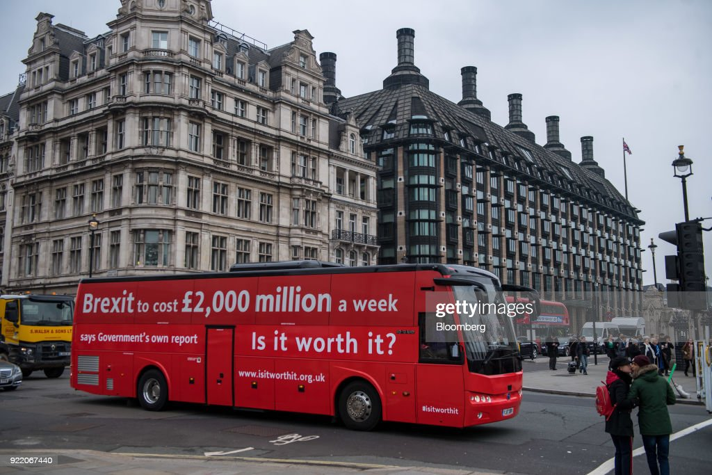 'Brexit to cost £2,000 million a week says government's own report. Is it worth it?' passes a crossing near the Houses of Parliament in London, U.K., on Wednesday, Feb. 21, 2018. With talk of a second referendum in the air, opponents of Brexit have decided to take their own red bus on the road. Photographer: Chris J. Ratcliffe/Bloomberg via Getty Images