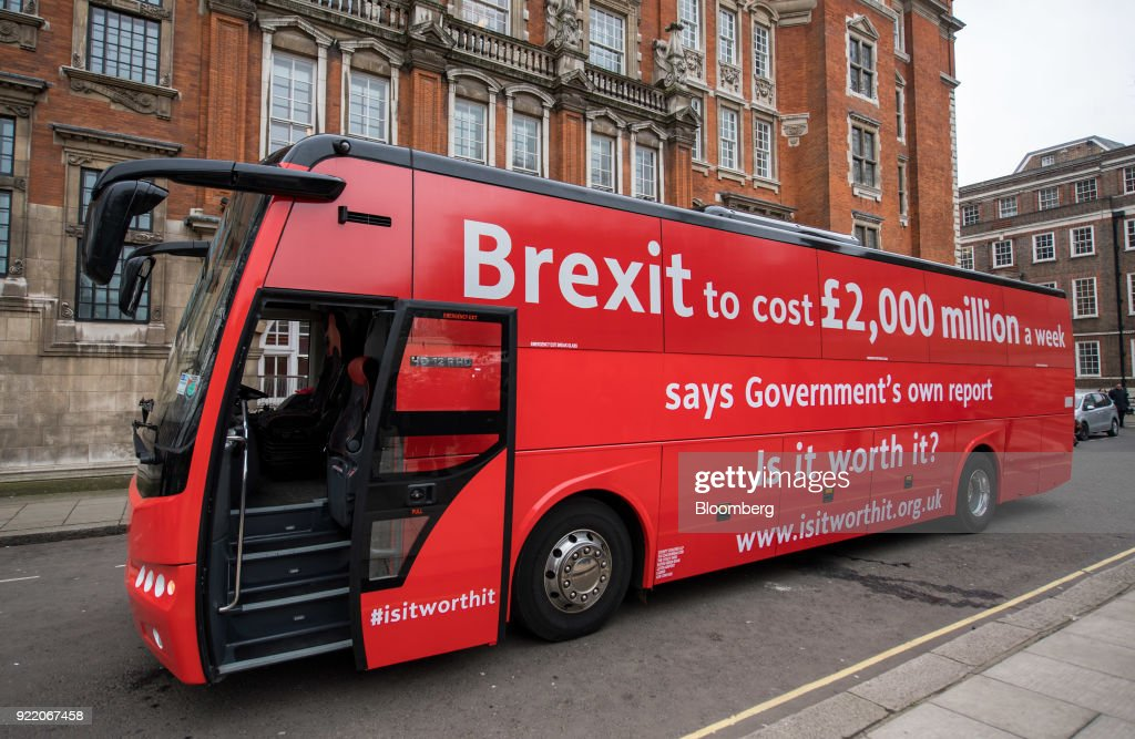 'Brexit to cost £2,000 million a week saysgovernment's own report. Is it worth it?' stands on a street during its inauguration in London, U.K., on Wednesday, Feb. 21, 2018. With talk of a second referendum in the air, opponents of Brexit have decided to take their own red bus on the road. Photographer: Chris J. Ratcliffe/Bloomberg via Getty Images