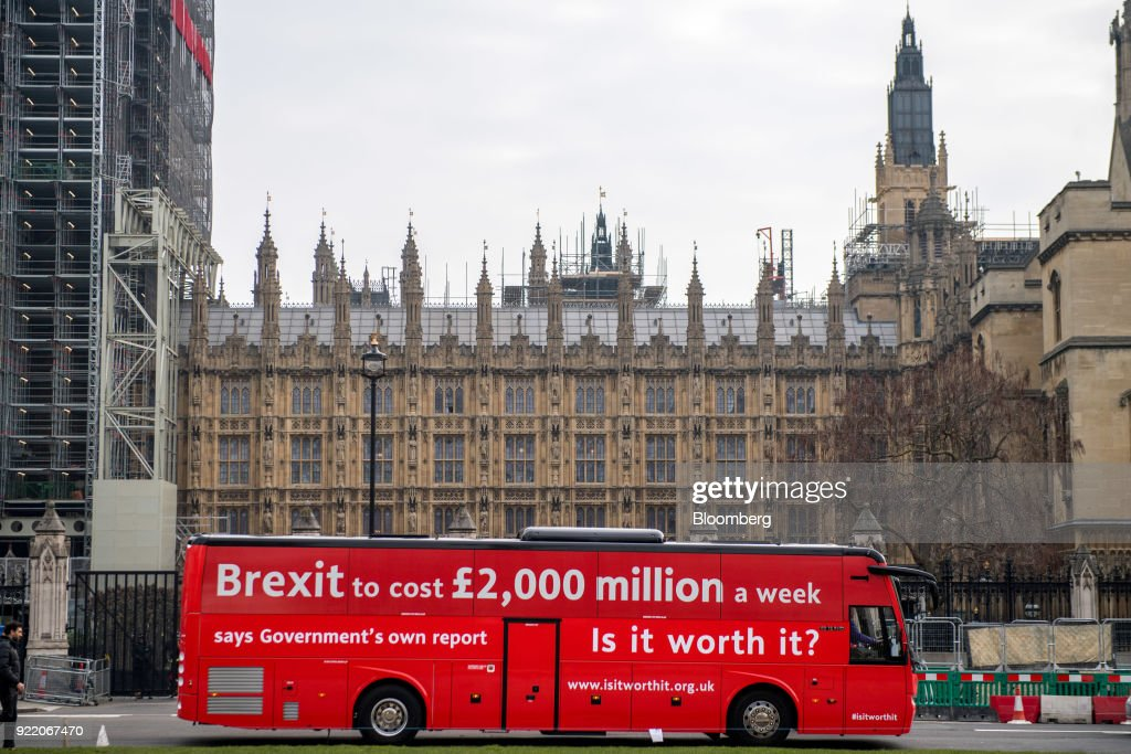 'Brexit to cost £2,000 million a week says government's own report. Is it worth it?' passes the Houses of Parliament in London, U.K., on Wednesday, Feb. 21, 2018. With talk of a second referendum in the air, opponents of Brexit have decided to take their own red bus on the road. Photographer: Chris J. Ratcliffe/Bloomberg via Getty Images