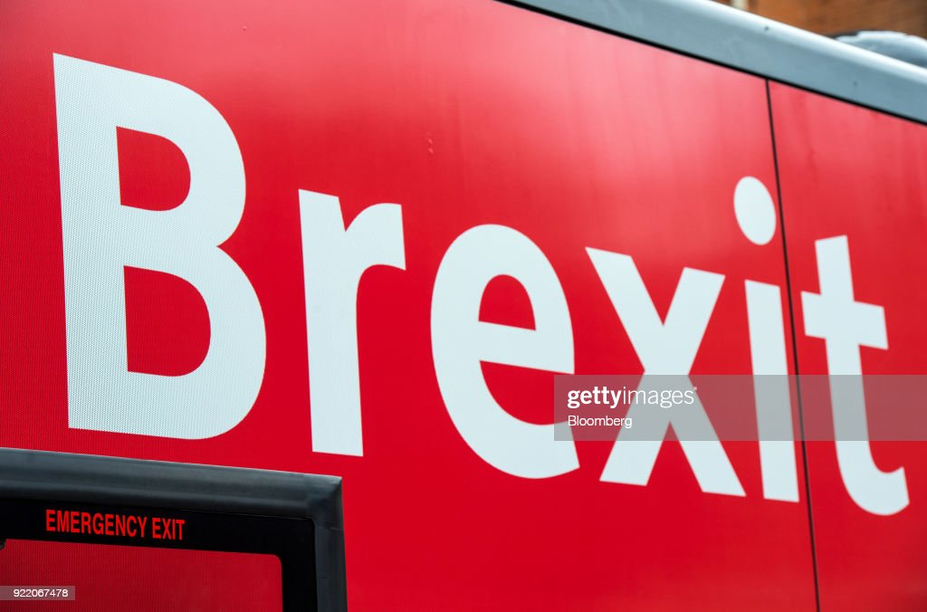 'Brexit to cost £2,000 million a week saysgovernment's own report. Is it worth it?' sits parked on a street as the emergency exit door stands open during its inauguration in London, U.K., on Wednesday, Feb. 21, 2018. With talk of a second referendum in the air, opponents of Brexit have decided to take their own red bus on the road. Photographer: Chris J. Ratcliffe/Bloomberg via Getty Images
