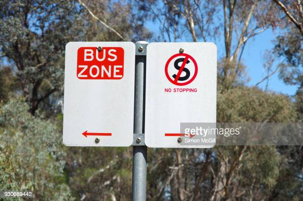 Bus Zone and No Stopping signs