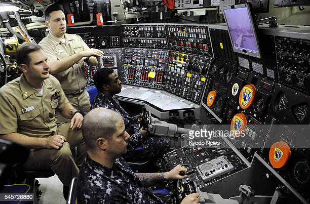 Busaan South Korea The inside of the US Navy nuclearpowered submarine Michigan is shown to reporters as it called at Busan South Korea on May 2 2011