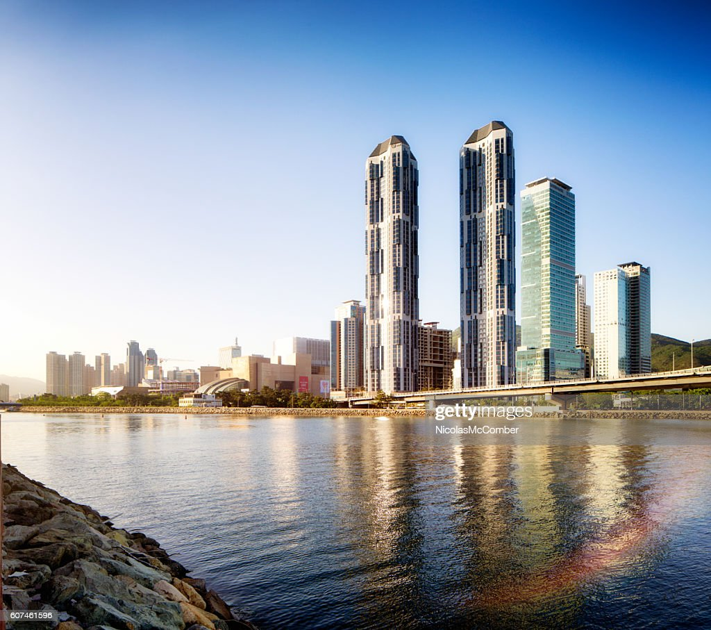 Busan Centum City skyline at sunset with river reflections : Stock Photo