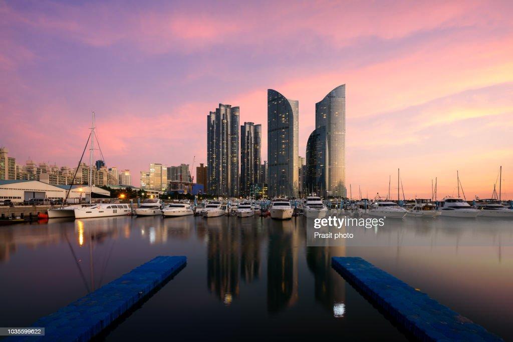 Busan city skyline view at Haeundae district, Gwangalli Beach with yacht pier at Busan, South Korea. : Stock Photo