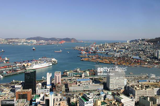 busan harbour and city - didier marti stock photos and pictures