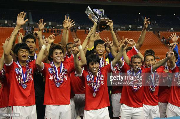 Busan I'Park FC celebrate with the trophy after defeating Yokohama FC 30 in the Championship Match of the Hawaiian Islands Invitational Soccer...