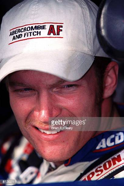 Busch Series Champion Dale Earnhardt Jr smiles as he sits in his car waiting to qualify for the season finale at Homestead Florida November 12 1999