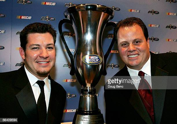 Busch Series champion Martin Truex Jr poses with crew chief Kevin Manion and the championship trophy during the NASCAR Busch Series Banquet at the...