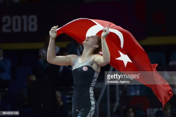 Buse Tosun of Turkey celebrates after winning against Monika Ewa Michalik of Poland during the women's 68 kg category match within the 2018 European...