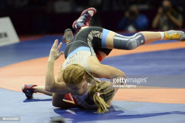 Buse Tosun of Turkey competes with Monika Ewa Michalik of Poland during the women's 68 kg category match within the 2018 European Wrestling...