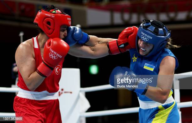 Busenaz Surmeneli of Team Turkey exchanges punches with Anna Lysenko of Team Ukraine during the Women's Welter quarter final on day seven of the...