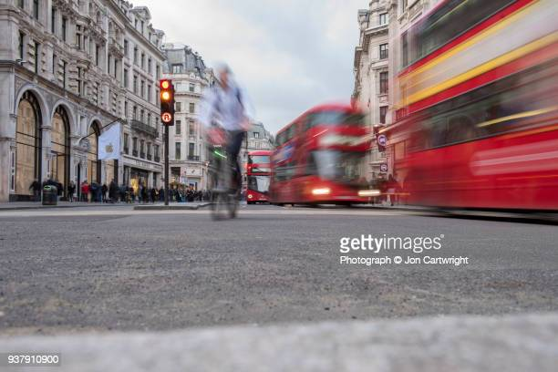 Buses and a cyclist on London's Regent Street