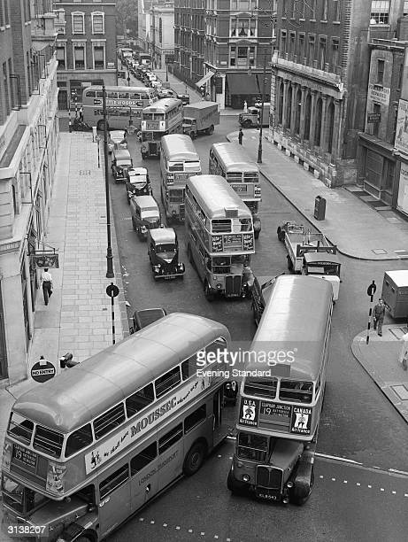 Buses and cars caught in a traffic jam at Bury Place London