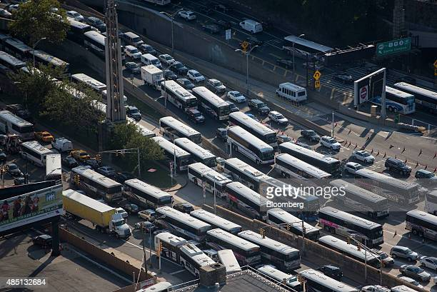Buses and cars sit in traffic at the Lincoln Tunnel in this aerial photograph taken above North Bergen US on Friday Aug 21 2015 New Jersey Transit...