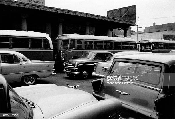 Buses and cars standing in Al Rasheed street Baghdad December 1956