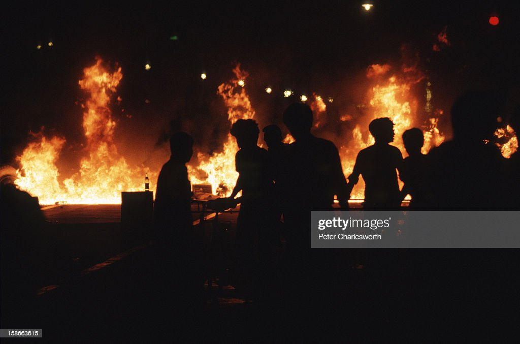 Buses and vehicles burn and pro-democracy demonstrators retreat down Changan Avenue as soldiers march and shoot their way towards Tiananmen Square on the night of the Communist Government's bloody crackdown on students and protestors..