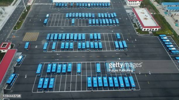 Buses are packed for departure at guanyun County Bus terminal in Lianyungang City, East China's Jiangsu Province, Aug. 4, 2021. Guanyun county new...
