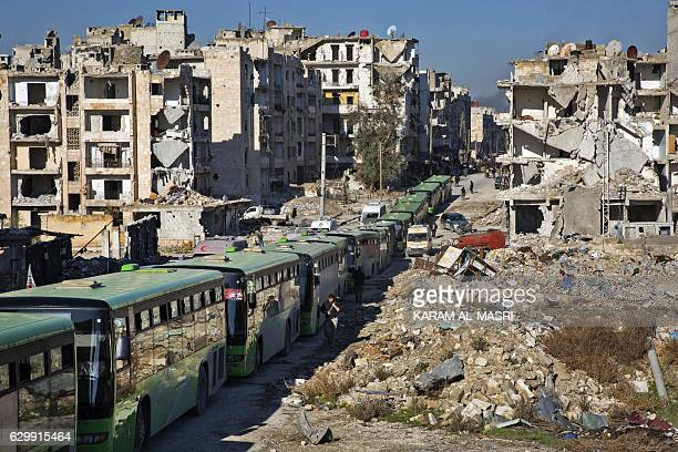 TOPSHOT Buses are seen during an evacuation operation of rebel fighters and their families from rebelheld neighbourhoods in the embattled city of...