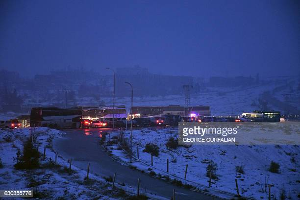 Buses are seen during an evacuation operation of Syrian rebel fighters and civilians from the remaining rebelheld pockets of eastern Aleppo towards...