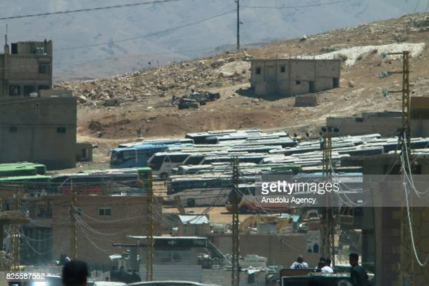Buses are seen during Syrian refugees' departure to Idlib after a ceasefire announced between Hezbollah and Ahrar alSham in Arsal town of Baalbek...