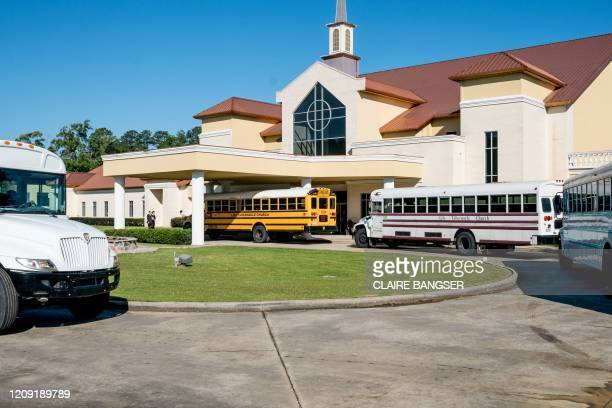 Buses bring church-goers from all over the Baton Rouge area to a Palm Sunday service at Life Tabernacle Church in Baton Rouge, Louisiana on April 5...