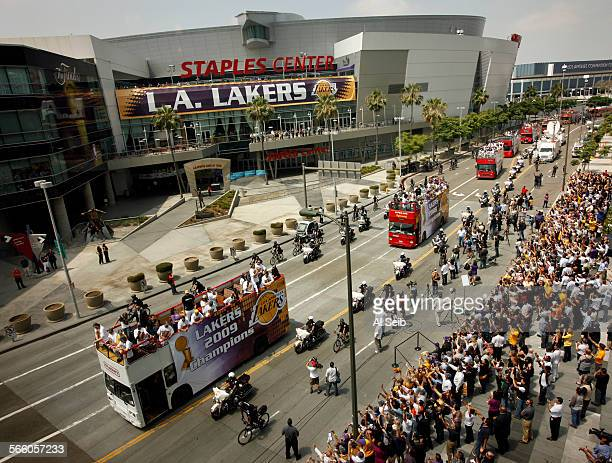 Buses carry Laker players at the start of the Laker victory parade as it proceeds along Chick Hearn Ct in front of the Staples Center Wednesday...