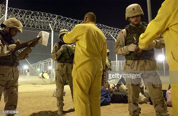 Buses carrying about 240 detainees from the notorious Abu Ghraib prison arrive at Camp Bucca the USrun detention center 300 miles south of Baghdad...