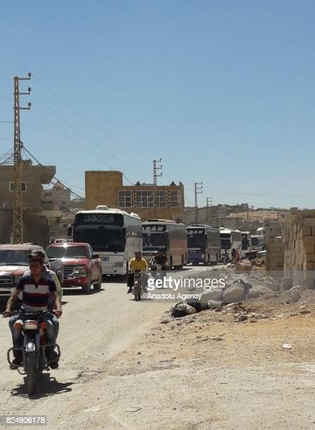 Buses carrying hundreds of Jabhat Fateh militants and their families depart from town of Arsal Baalbek to Syria's northwestern province of Idlib as...