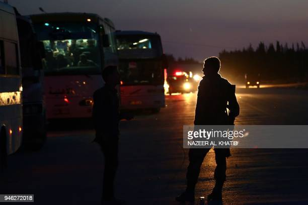 Buses carrying Jaish al-Islam fighters and their families from the former rebel bastion of Douma in Eastern Ghouta, arrive at the Abu al-Zindeen...