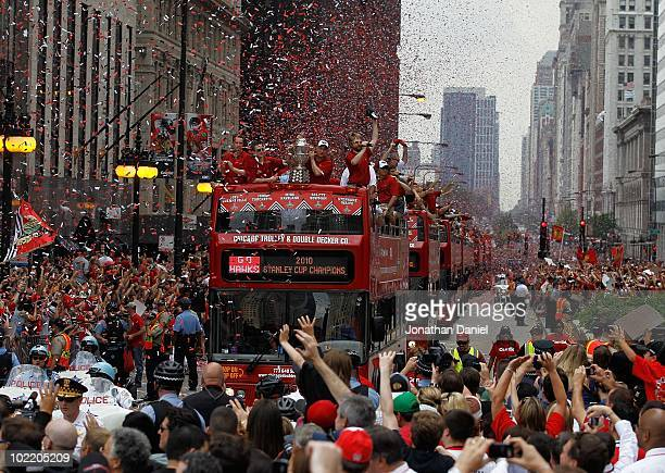 Buses carrying members of the Chicago Blackhawks players staff and families make their way down Michigan Avenue during the Chicago Blackhawks Stanley...