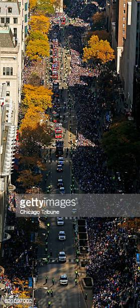 Buses carrying the World Series Champion Chicago Cubs make their way south on Michigan Ave Friday Nov 4 2016 during a massive parade held in their...