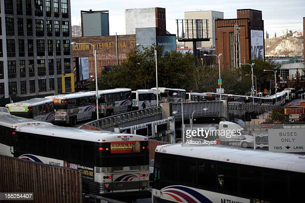 Buses drive into the Lincoln Tunnel from Port Authority November 2 2012 in New York City Limited public transit has returned to New York With the...
