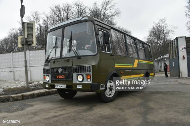 Buses drive out of the the Russian Government airport Vnukovo II after the Russian Il96 jet brought back 46 Russian diplomats and their family...