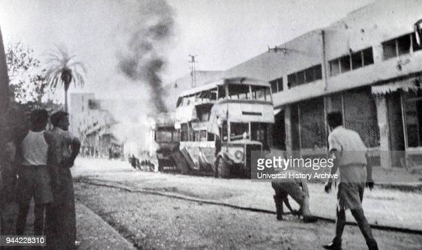 Buses in Tel Aviv Israel are damaged during an air raid in the 1948 War of Independence