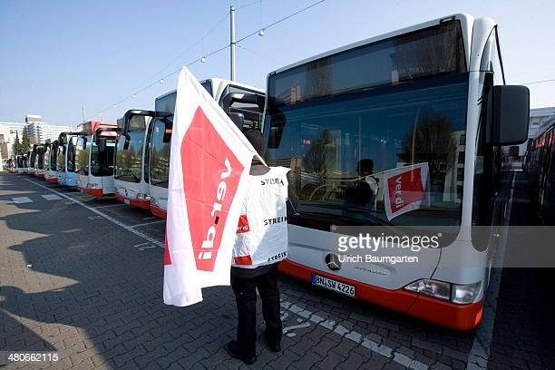 Buses lined up in the depot of the Stadtwerke Bonn and a picket with Verdi flag seen during the Bus and train strike of union Verdi on March 26 2014...