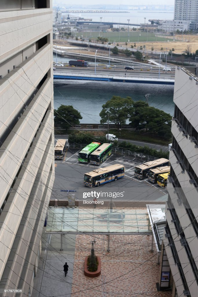 Buses operated by City of Yokohama sit in a parking lot in Yokohama, Japan, Saturday, Feb. 3, 2018. Japans economy expanded for an eighth quarter, with its gross domestic product (GDP) grew at an annualized rate of 0.5 percent in the three months ended Dec. 31, but the pace of growth fell sharply and missed expectations. Photographer: Takaaki Iwabu/Bloomberg via Getty Images