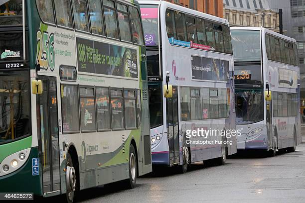 Buses queue up for passengers on the streets of Manchester on February 26 2015 in Manchester United Kingdom As the United Kingdom prepares to vote in...
