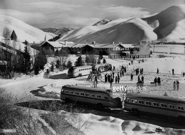 Buses shuttling skiers between Sun Valley and the ski slopes at the Idaho resort for screen stars and other wealthy Americans